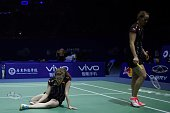 Birgit Michels and Isabel Herttrich of Germany react after losing a point against Yu Yang and Tang Yuanting of China during their women's doubles...