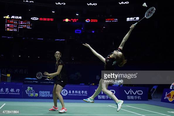 Birgit Michels and Isabel Herttrich of Germany return to Yu Yang and Tang Yuanting of China during their women's doubles match of the 2015 Sudirman...