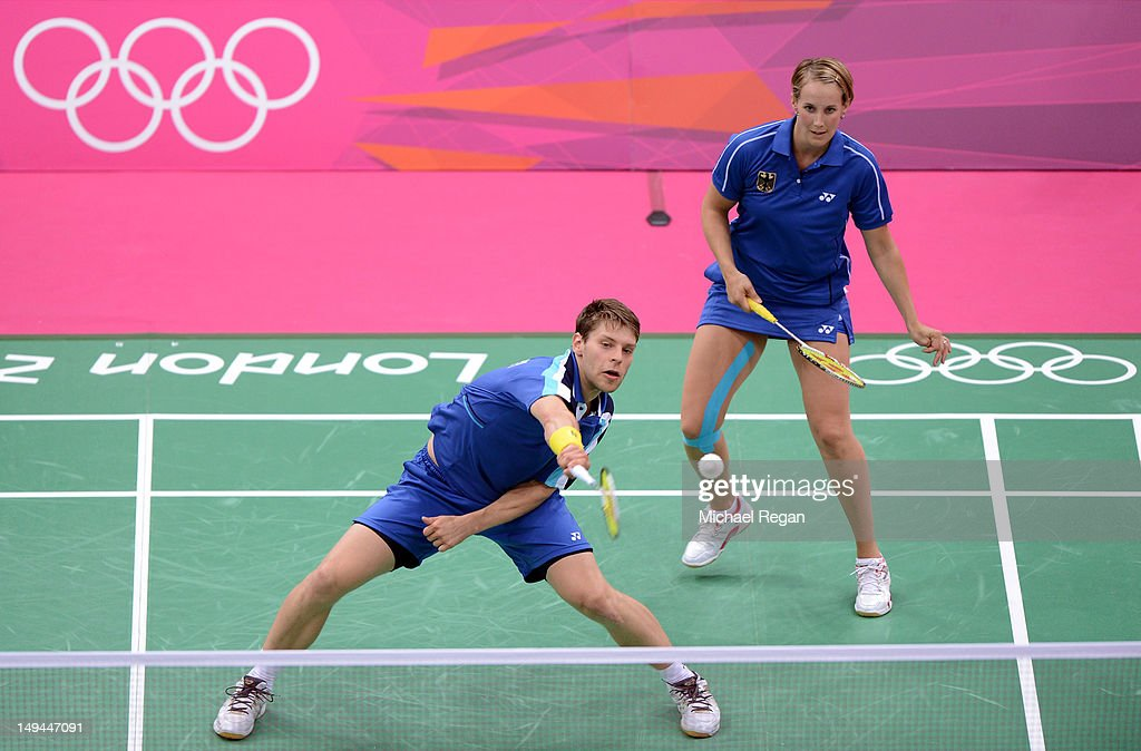 Birgit Michels (R) and Michael Fuchs (L) of Germany return a shot against Yunlei Zhao and Nan Zhang of China during their Mixed Doubles Badminton on Day 1 of the London 2012 Olympic Games at Wembley Arena on July 28, 2012 in London, England.