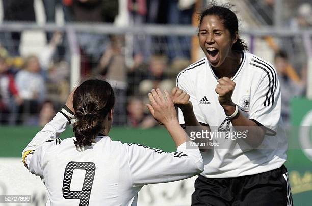 Birgit Prinz and Steffi Jones of Germany celebrate scoring the second goal during the Women's International friendly match between Germany and Canada...