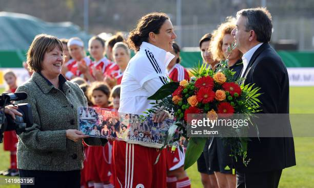 Birgit Prinz is hounored by DFB vice president Hannelore Ratzeburg and DFB president Wolfgang Niersbach prior to the Birgit Prinz farewell match...