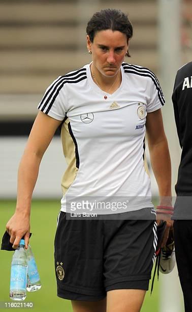 Birgit Prinz leaves injured the pitch during a German Women National Team training session on June 12 2011 in Neu Isenburg Germany