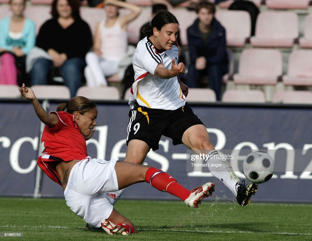 Birgit Prinz of Germany and Alex Scott of England battle for the ball during the Women's International friendly match between Germany and England at...