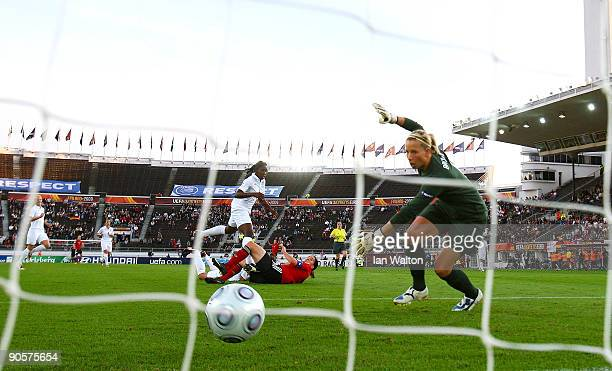 Birgit Prinz of Germany scores the first goal during the UEFA Women's Euro 2009 Final match between England and Germany at the Helsinki Olympic...
