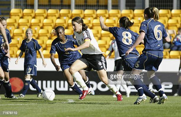 Birgit Prinz of Germany vies for the ball with Nicola Grant of Scotland during the Women's FIFA World Cup qualifying match between Scotland and...
