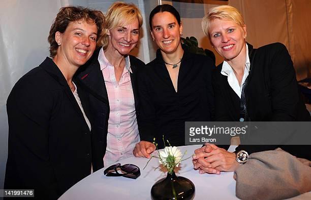 Birgit Prinz smiles with Steffi Nerius Heike Drechsler and Doris Fitschen during the Birgit Prinz farewell party on March 27 2012 in Frankfurt am...