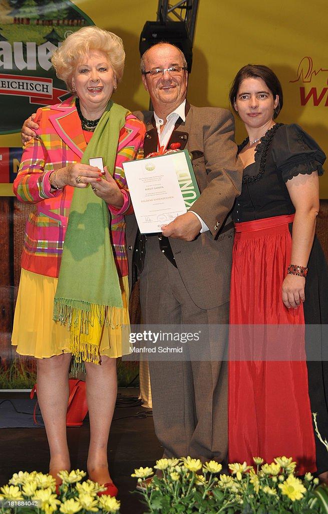 Birgit Sarata (L) is presented with an award by Willy Turecek during the 'Wiener Wirten Tag' as part of Wiener Wiesn Festival 2013 on September 25, 2013 in Vienna, Austria.