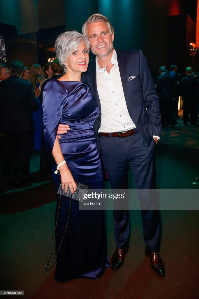 Birgit Schrowange and Frank Spothelfer pose at the Bambi Awards 2017 party at Atrium Tower on November 16, 2017 in Berlin, Germany.