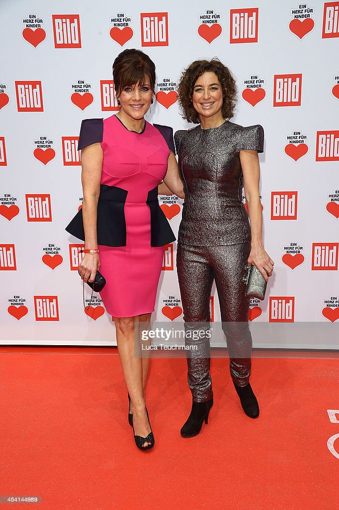 Birgit Schrowange and Isabel Varell attend the Ein Herz Fuer Kinder Gala 2013 at Flughafen Tempelhof on December 7, 2013 in Berlin, Germany.