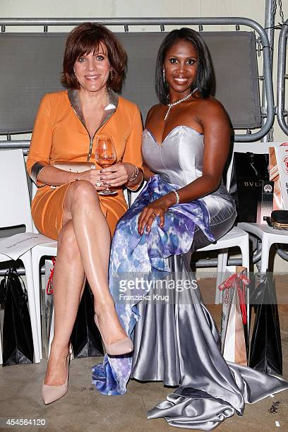 Birgit Schrowange and Motsi Mabuse attend the Blurry Garden Couture Collection Presentation in a nuclear bunker on September 03 2014 in Berlin Germany