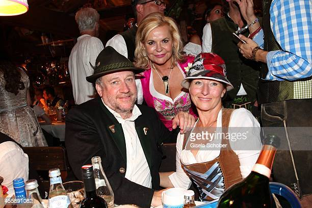 Birgitt Wolff Tessy Pavelkova Harold Faltermeyer attend the 'Almauftrieb' at Kaefer tent during Oktoberfest at Theresienwiese on September 21 2014 in...