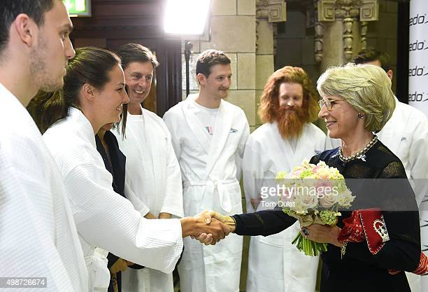 Birgitte Duchess of Gloucester greets KeriAnne Payne during the House of Commons v House of Lords Speedo Charity Swim Gala Dinner at Porchester Hall...