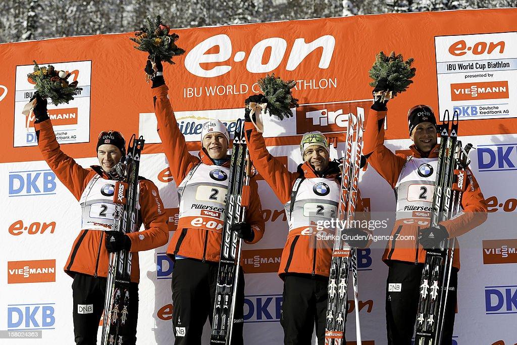 Birkeland Lars Helge, Ole Einar Bjoerndalen, Christiansen Vetle Sjestad of Norway, L'abee-Lund Henrik take 1st place during the IBU Biathlon World Cup Men's Relay on December 9, 2012 in Hochfilzen, Austria.