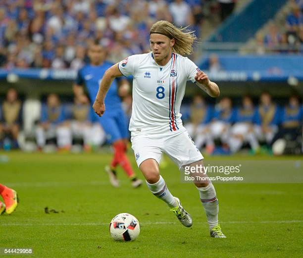 Birkir Bjarnason in action for Iceland during the UEFA EURO 2016 quarter final match between France and Iceland at Stade de France on July 3 2016 in...