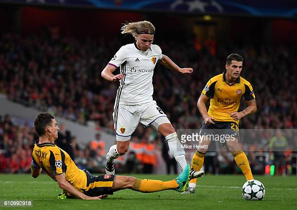 Birkir Bjarnason of Basel battles for the ball with Laurent Koscielny of Arsenal during the UEFA Champions League group A match between Arsenal FC...