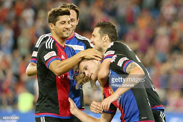 Birkir Bjarnason of FC Basel celebrates with his teammates after scoring his team's first goal during the UEFA Champions League third qualifying...