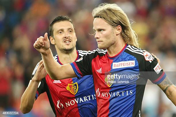 Birkir Bjarnason of FC Basel celebrates with teammate Zdravko Kuzmanovic after scoring his team's first goal during the UEFA Champions League third...