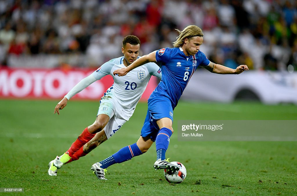 <a gi-track='captionPersonalityLinkClicked' href=/galleries/search?phrase=Birkir+Bjarnason&family=editorial&specificpeople=7137549 ng-click='$event.stopPropagation()'>Birkir Bjarnason</a> of Iceland and <a gi-track='captionPersonalityLinkClicked' href=/galleries/search?phrase=Dele+Alli&family=editorial&specificpeople=9976958 ng-click='$event.stopPropagation()'>Dele Alli</a> of England compete for the ball during the UEFA EURO 2016 round of 16 match between England and Iceland at Allianz Riviera Stadium on June 27, 2016 in Nice, France.