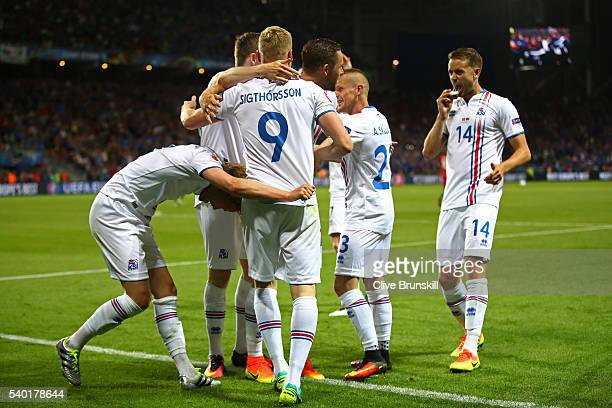 Birkir Bjarnason of Iceland celebrates scoring his team's first goal with his team mates during the UEFA EURO 2016 Group F match between Portugal and...