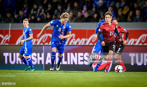 Birkir Bjarnason of Iceland challenges Emre Mor of Turkey during the FIFA 2018 World Cup Qualifier between Iceland and Turkey at Laugardalsvoellur on...