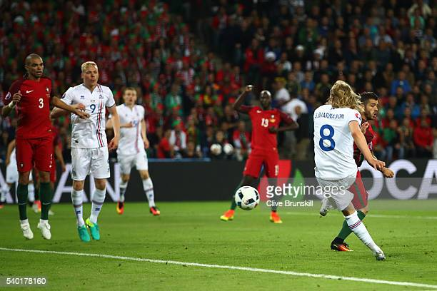 Birkir Bjarnason of Iceland scores his team's first goal during the UEFA EURO 2016 Group F match between Portugal and Iceland at Stade...