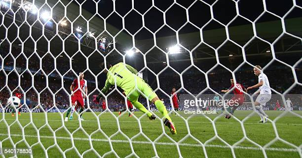 Birkir Bjarnason of Iceland scores his team's first goal past Rui Patricio of Portugal during the UEFA EURO 2016 Group F match between Portugal and...