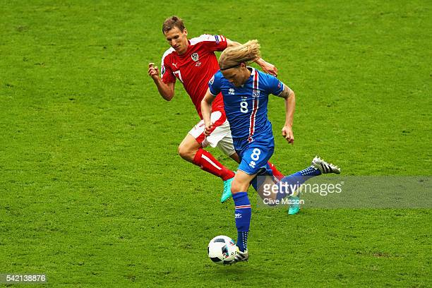 Birkir Bjarnason of Iceland takes on Florian Klein of Austria during the UEFA EURO 2016 Group F match between Iceland and Austria at Stade de France...