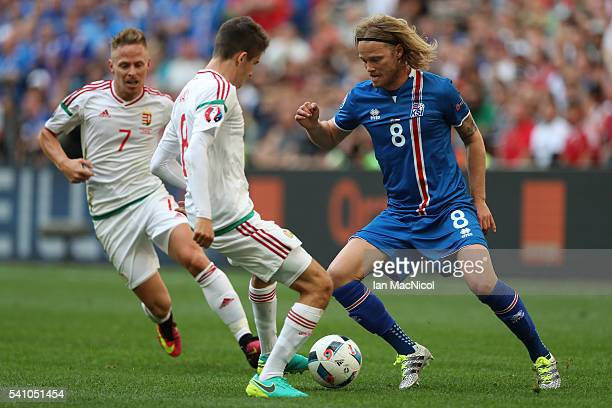 Birkir Bjarnason of Iceland vies with Adam Nagy of Hungary during the UEFA EURO 2016 Group F match between Iceland and Hungary at Stade Velodrome on...