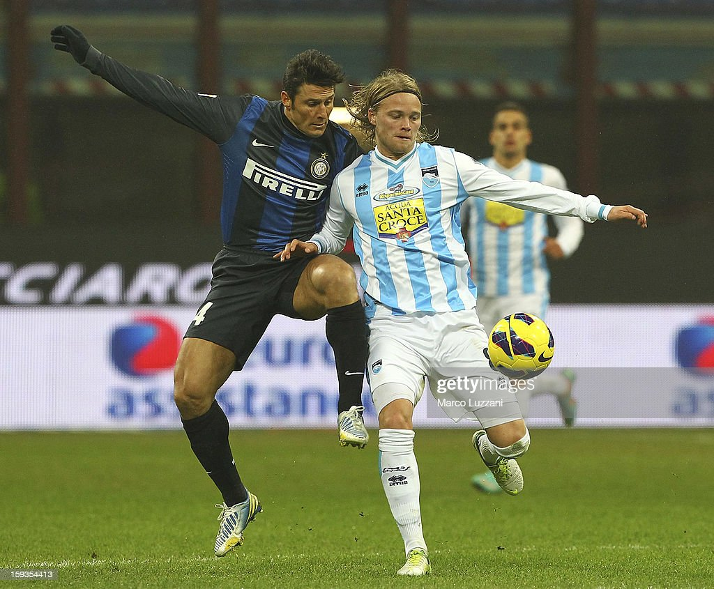 Birkir Bjarnason (R) of Pescara Calcio competes for the ball with <a gi-track='captionPersonalityLinkClicked' href=/galleries/search?phrase=Javier+Zanetti&family=editorial&specificpeople=206966 ng-click='$event.stopPropagation()'>Javier Zanetti</a> (L) of FC Internazionale Milano during the Serie A match between FC Internazionale Milano and Pescara at San Siro Stadium on January 12, 2013 in Milan, Italy.