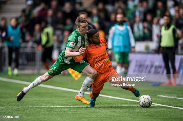 Birkir Mar Saevarsson of Hammarby IF and Jernade Mead of Athletic FC Eskilstuna during the Allsvenskan match between Hammarby IF and Athletic FC...