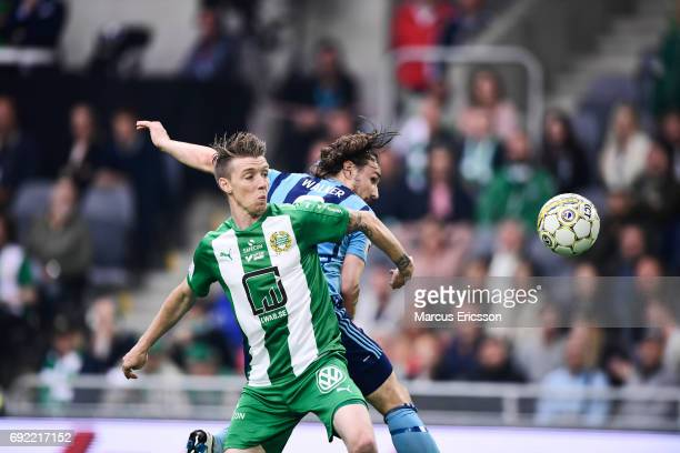 Birkir Mar Saevarsson of Hammarby IF and Kevin Walker of Djurgardens IF competes for the ball during the Allsvenskan match between Hammarby IF and...