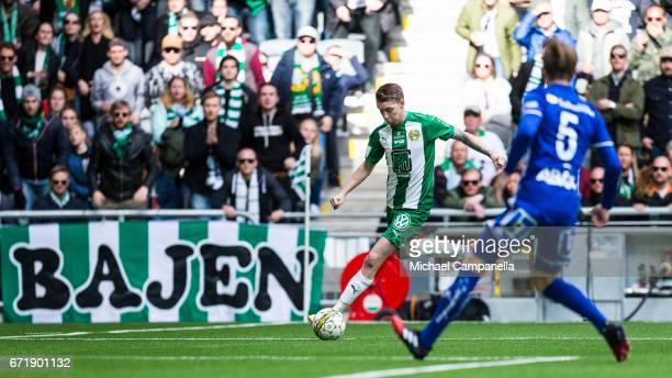 Birkir Mar Saevarsson of Hammarby IF looks to play a cross as Erik Bjorklander of GIF Sundsvall closes in during an Allsvenskan match between...