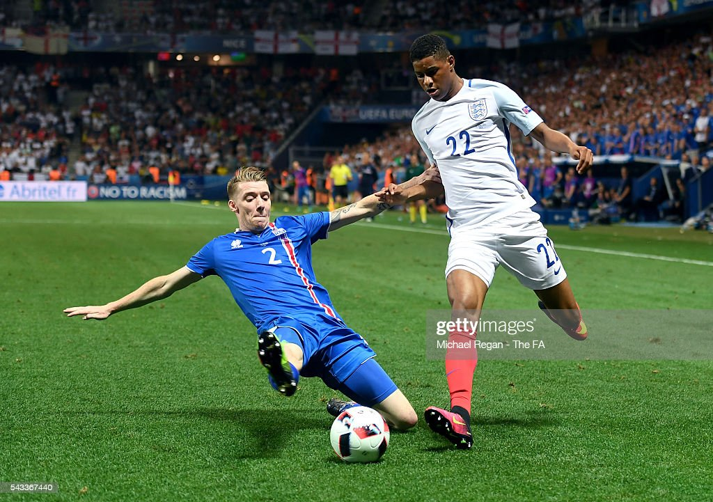 Birkir Saevarsson of Iceland slides in to tackle <a gi-track='captionPersonalityLinkClicked' href=/galleries/search?phrase=Marcus+Rashford&family=editorial&specificpeople=13847707 ng-click='$event.stopPropagation()'>Marcus Rashford</a> of England during the UEFA EURO 2016 round of 16 match between England and Iceland at Allianz Riviera Stadium on June 27, 2016 in Nice, France.