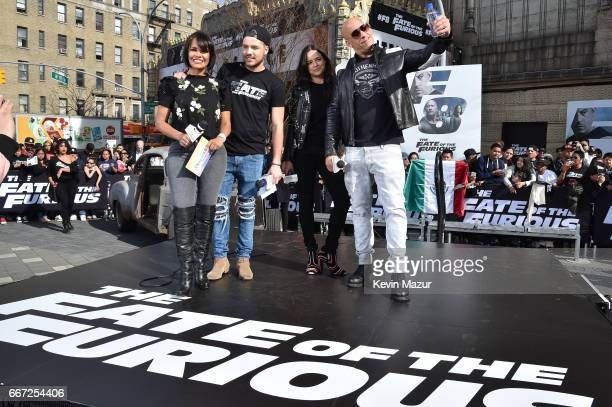 Birmania Rios and William Valdes speak to Michelle Rodriguez and Vin Diesel as they visit Washington Heights on behalf of 'The Fate Of The Furious'...