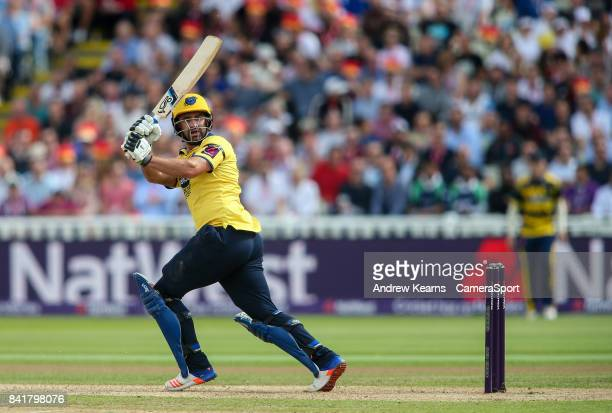 Birmingham Bears' Colin De Grandhomme hits the ball to the boundary for four during the NatWest T20 Blast SemiFinal match between Birmingham Bears...