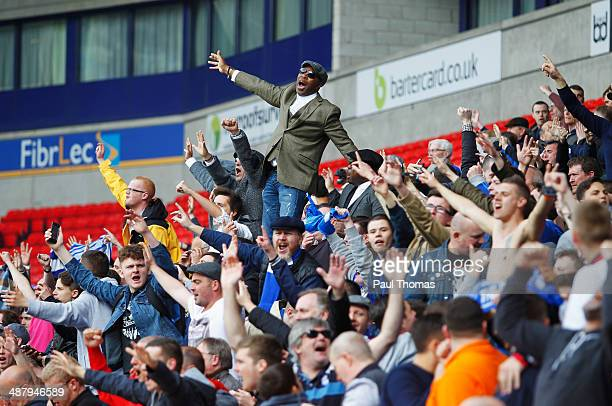Birmingham City fans celebrate as they avoid relegation after the Sky Bet Championship match between Bolton Wanderers and Birmingham City at Reebok...