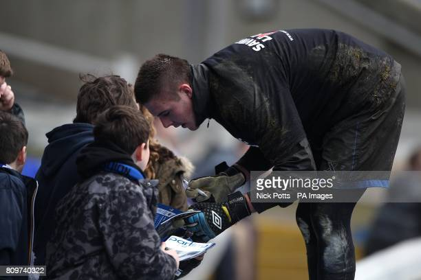 Birmingham City goalkeeper Jack Butland signs autographs for fans before the match
