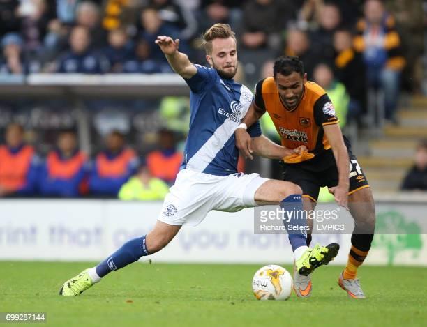 Birmingham City's Andrew Shinnie challenges Hull City's Ahmed Elmohamady