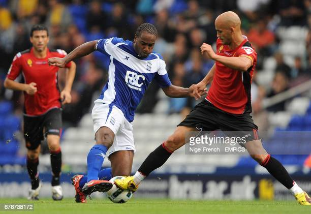 Birmingham City's Cameron Jerome and Real Mallorca's Jose Nunes battle for the ball