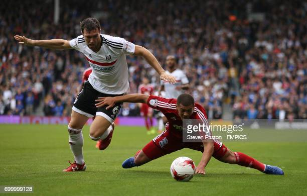 Birmingham City's Che Adams and Fulham Kevin McDonald battle for the ball