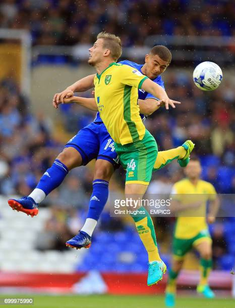 Birmingham City's Che Adams and Norwich City's Ryan Bennett contest a header