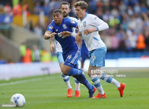 Birmingham City's Che Adams and Sheffield Wednesday's Adam Reach battle for the ball