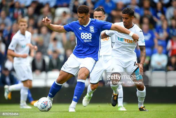 Birmingham City's Che Adams and Swansea City's Kyle Naughton battle for the ball