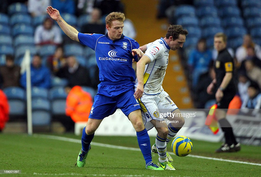 Birmingham City's Chris Burke and Leeds United's Aidan White during the FA Cup with Budweiser Third Round match between Leeds United and Birmingham City at Elland Road Stadium on January 5, 2013 Leeds, England.