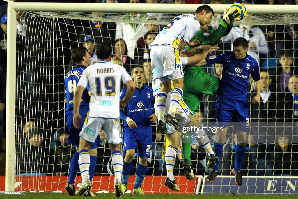 Birmingham City's Colin Doyle catches cleanly under pressure from Leeds United's Jason Pearce during the FA Cup with Budweiser Third Round match between Leeds United and Birmingham City at Elland Road Stadium on January 5, 2013 Leeds, England.