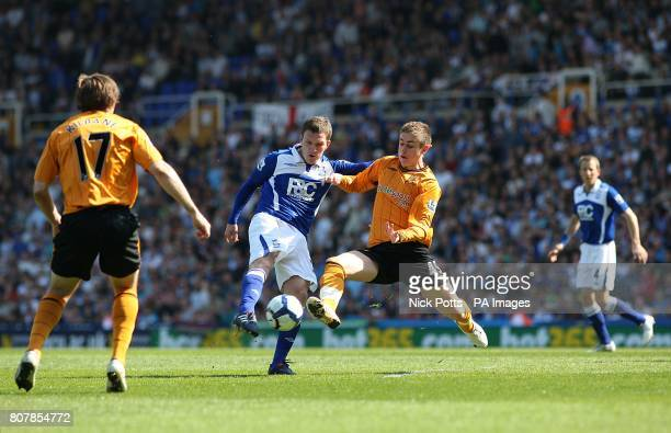Birmingham City's Craig Gardner and Hull City's Tom Cairney battle for the ball
