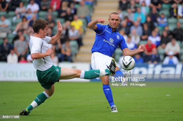 Birmingham City's David Murray passes the ball as Plymouth Argyle's Luke Young comes in to tackle during the PreSeason Friendly at Holme Park Plymouth