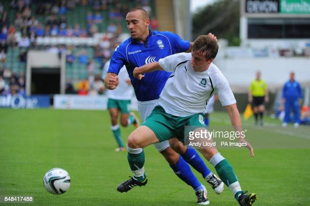 Birmingham City's David Murray takes the ball past Plymouth Argyle Luke Young during the PreSeason Friendly at Holme Park Plymouth