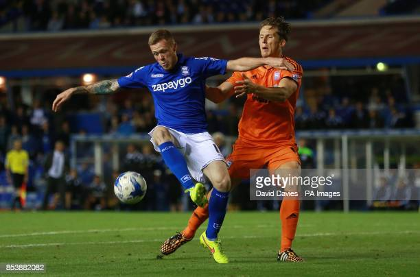 Birmingham City's Denny Johnstone and Ipswich Town's Christophe Berra during the Sky Bet Championship match at St Andrews Birmingham