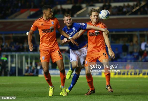 Birmingham City's Denny Johnstone is blocked by Ipswich Town's Christophe Berra during the Sky Bet Championship match at St Andrews Birmingham